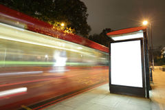 Blank billboard in bus stop. At night with the lights of the cars passing by, great copy space for your design, shot in London, United Kingdom, uk stock photos