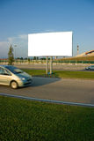 Blank billboard and car. Blank billboard on the street over passing car royalty free stock photo