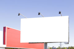 Blank billboard in the city against blue sky Stock Photo