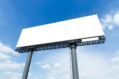 Blank billboard. In city on blue sky and white cloud ready to use for advertisement stock photography