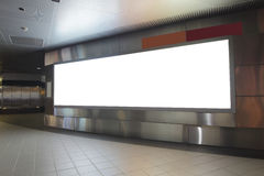 Blank billboard in the city building. Shot in subway station, white empty copy space is great for user Stock Image