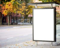 Blank billboard on city bus station stock photo
