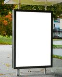 Blank billboard on city bus station royalty free stock photography