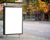 Blank billboard on city bus station Stock Images