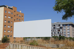 Blank billboard in the city. Blank billboard in front of new buildings Royalty Free Stock Image
