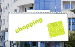 Blank billboard in city with shopping bag Stock Images