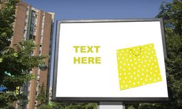 Blank billboard in city with shopping bag Stock Photos
