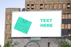 Blank billboard in city with shopping bag Stock Image