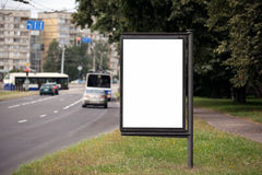 Blank Billboard on City Street. Transport and people in the background Royalty Free Stock Photos