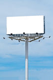 Blank billboard on cloudy sky Stock Photos