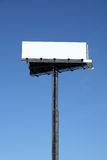 Blank billboard with copy space. Against the blue sky royalty free stock photo