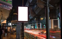 Blank billboard with copy space area for your text message or pr. Omotional content, public information board next to road in night background stock photo