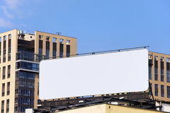 Blank Billboard in Downtown. Large blank billboard on a building roof in the city downtown stock images