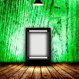 Blank billboard in empty dark room. Stock Image
