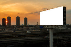 Blank billboard beside express way at sunset Royalty Free Stock Images