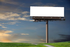 Blank billboard in a field Stock Image