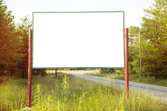 Blank billboard. In a forest royalty free stock photography