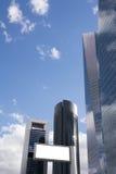 Blank billboard in front of office skyscraper Stock Photo