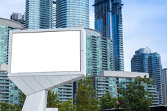 Blank billboard in front of tall office and apartment buildings. Huge blank billboard in front of tall office and apartment buildings in the city of Toronto Royalty Free Stock Photo