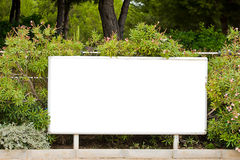 Blank billboard garden Royalty Free Stock Image