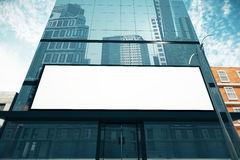 Blank billboard. On glassy wall of business center, mock up, 3D Render Royalty Free Stock Images