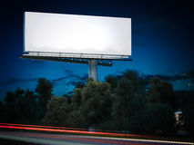 Blank billboard glowing at night. 3d rendering. Blank billboard glowing at night on the road. 3d rendering Royalty Free Stock Photos