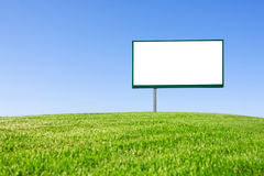 Blank billboard on green field Royalty Free Stock Images