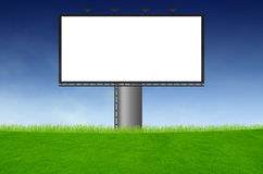 Blank billboard on green field Royalty Free Stock Photography