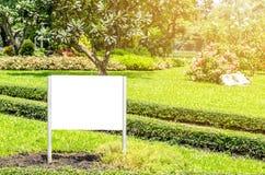 Blank billboard in green field Stock Photo