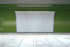 Blank billboard on green wall in empty subway, mock up, 3D rende. R Stock Photo