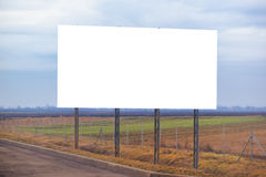 Blank billboard hoarding by the roadway. Copy space for graphic design mock up stock photography