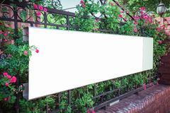 Blank billboard on iron fence Royalty Free Stock Image