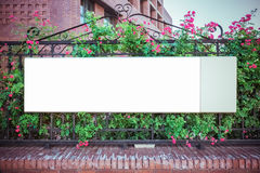 Blank billboard on iron fence Stock Image