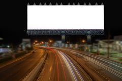 Blank billboard and light on highway road in night time. Stock Image