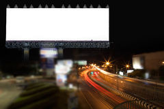 Blank billboard and light on highway road in night time. Stock Images