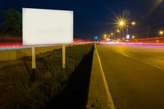 Blank billboard on main street road Stock Images