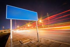 Blank billboard on main street road Stock Photo