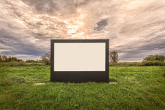 Blank billboard on a meadow Stock Images
