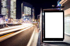 Blank Billboard in Milan. With Fast Traffic and Skyscrapers in Background Royalty Free Stock Photo
