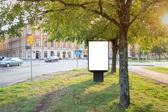 Blank billboard mock up on city road for text message or content stock image