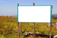 Blank billboard in a mountain landscape Stock Photo