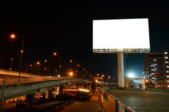 Blank billboard near express way at night for advertisement Royalty Free Stock Images