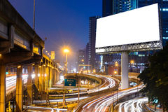 Blank billboard near expressway at night for advertisement Royalty Free Stock Image