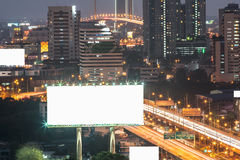Blank billboard near expressway at night for advertisement. Royalty Free Stock Image