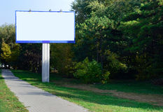 Blank billboard near trees. Billboard installed near the path stock images