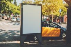 Blank billboard near yellow taxi Stock Photo
