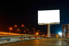 Blank billboard at night for advertisement Royalty Free Stock Photos