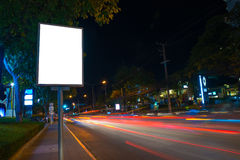 Blank billboard at night of side Street with lights from the car. Stock Image