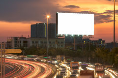 Blank billboard at night time for advertisement. street light . Stock Photos