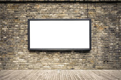 Blank billboard on old brick wall. Blank advertising light box in the old brick wall for your advertisement Stock Image